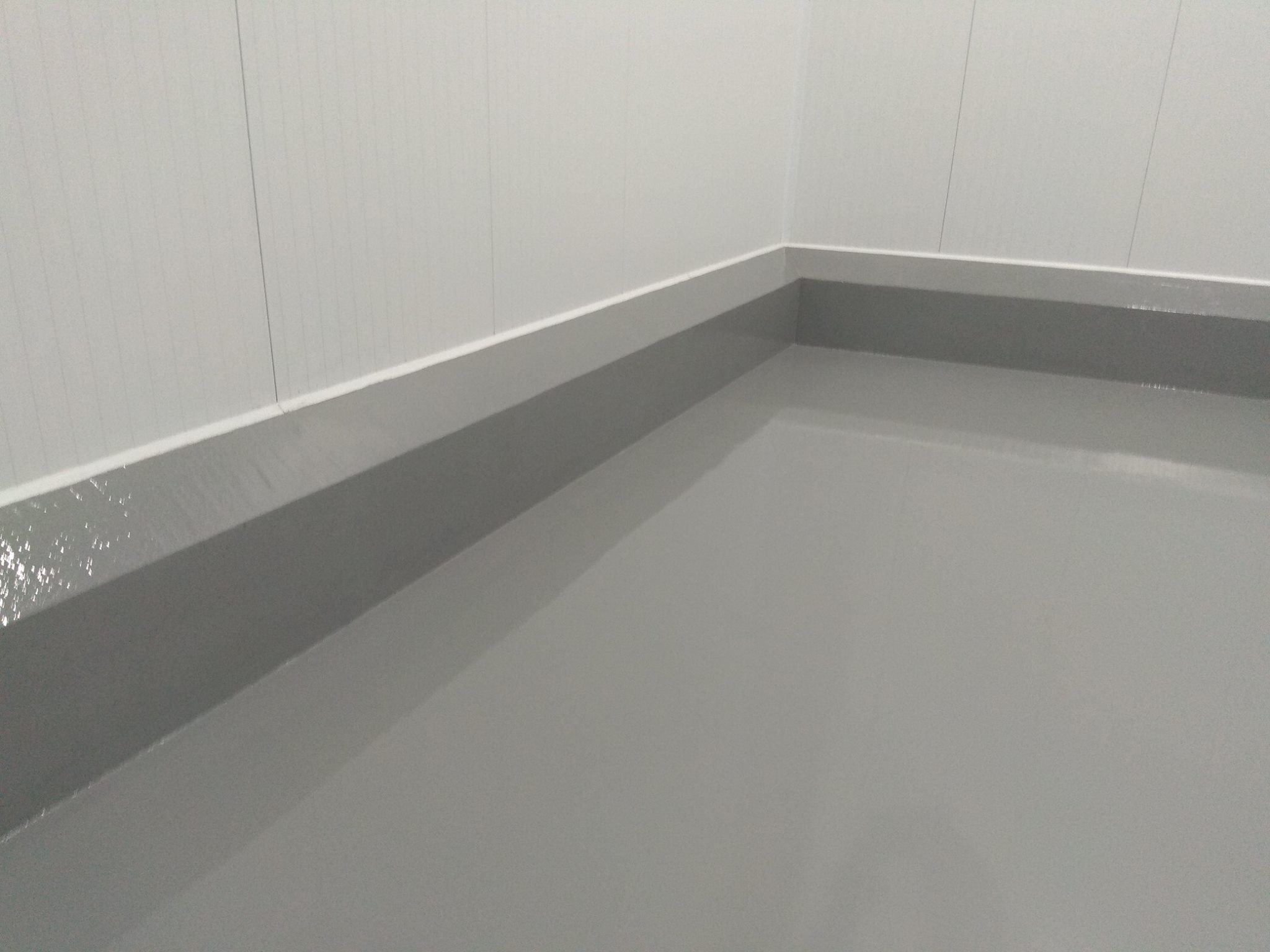 Kerb and floor coated in epoxy paint.