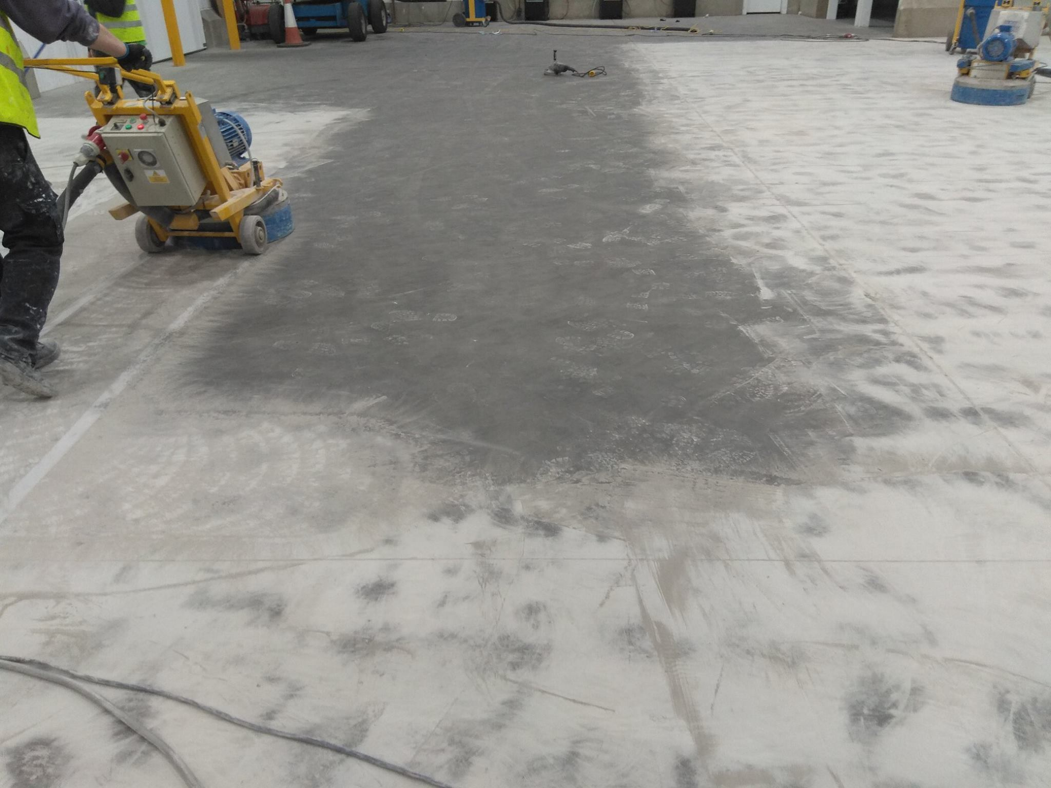 Grinding surface to clean & prep for sealing.
